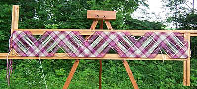 A Spriggs 7' Adjustable Rectangle Frame Loom on a folding Tripod Stand. Click for larger images and more information.
